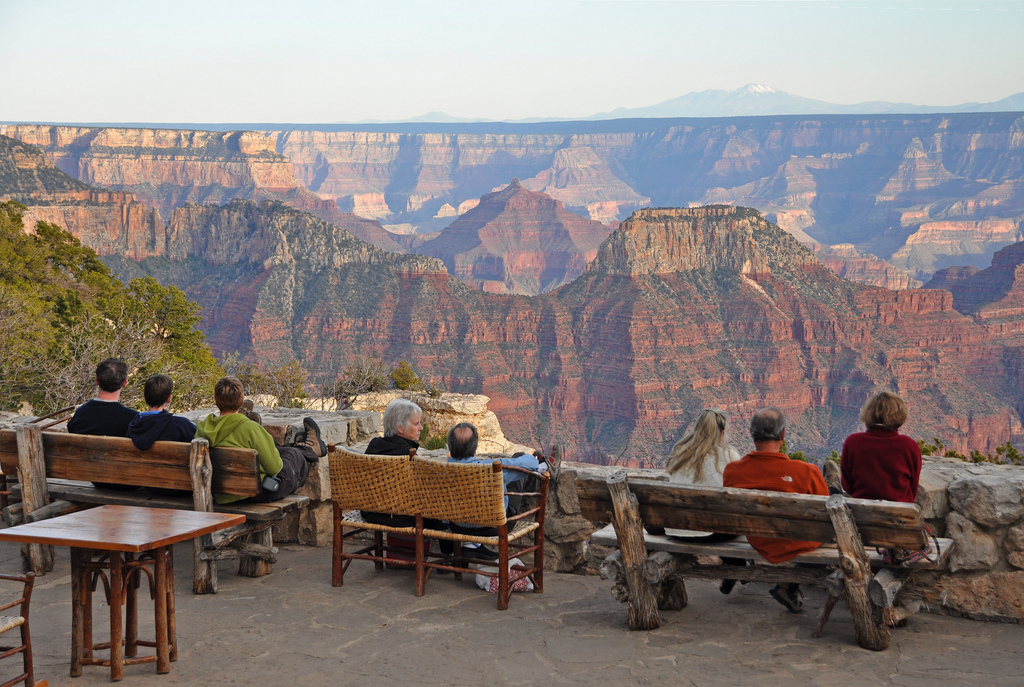 Visitors sit peacefully as they overlook the Grand Canyon North Rim.
