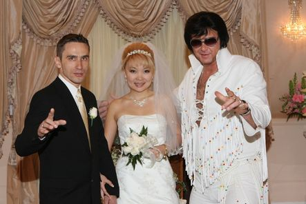 couple being married in las vegas with Elvis